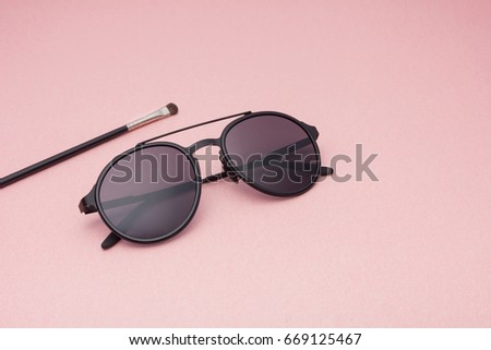 CREATIVE SHOOT OF SUNGLASSES WITH COLORFUL BACKGROUND AND COOL PROPS.