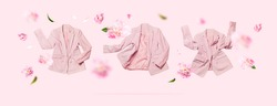 Creative Spring clothing concept. Womens fashionable flying pink blazer and delicate flowers peonies on light pink background. Female fashion, stylish fabric cotton jacket. Sale, springtime discounts