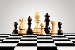 Creative success business strategy and leadership concept meaningful photo of black and white wooden chess figures standing on the checkerboard ready for game.
