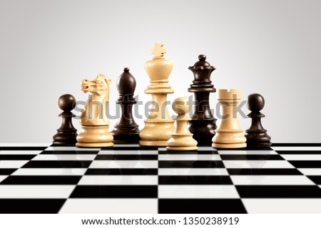 Creative success business strategy and leadership concept meaningful photo of black and white wooden chess figures standing on the checkerboard ready for game. #1350238919