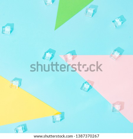 Creative summer background composition with ice cubes and colorful paper shapes. Minimal top down. #1387370267
