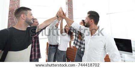 creative team giving each other a high five #744418702