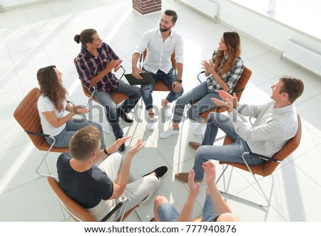 creative team holds a meeting in the lobby