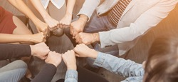 Creative team meeting fist bumps circle, hands together, asian people teamwork acquisition, brainstorm business people concept. Startup friends creative people sale project panoramic banner (blur)