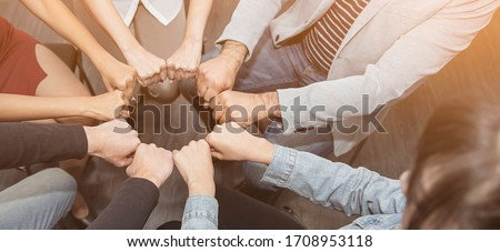 Creative team meeting fist bumps circle, hands together, asian people teamwork acquisition, brainstorm business people concept. Startup friends creative people sale project panoramic banner (blur) Stock foto ©