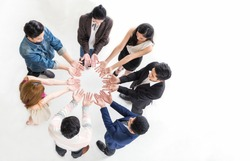 Creative team meeting hands together in circle, top view asian caucasian people family teamwork unity acquisition, brainstorm business multicultural people concept. Startup friends people project