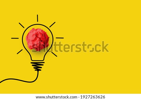 Creative thinking ideas and innovation concept. Paper scrap ball red colour with light bulb symbol on yellow background Foto d'archivio ©