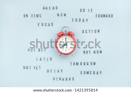 Creative top view flat lay of alarm clock with messages about delay or starting doing task copy space blue background minimal style. Concept of procrastination, time management in business and life Сток-фото ©