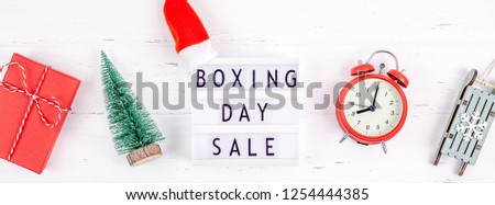 Creative Top view flat lay promotion composition Boxing day sale text on lightbox white background copy space Template Boxing day sale mockup winter christmas seasonal offer promotion advertising #1254444385