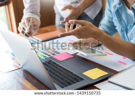 Creative UI designer teamwork meeting planning designing wireframe layout  application development mockup on smartphone screen for web mobile phone technology  #1439150735