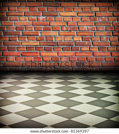 creative vintage interior with brick wall and chess tile floor