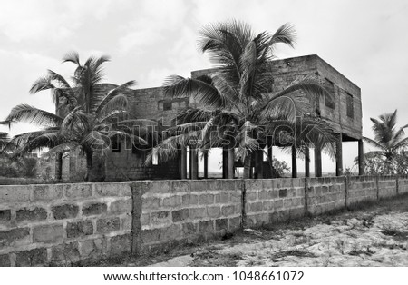 Creative vintage. Palm trees on a background of unfinished building. Abandoned house. Old photo. Retro