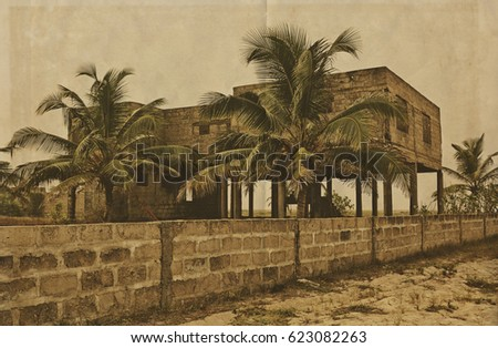 Creative vintage. Palm trees on a background of unfinished building. Abandoned house. Retro. Old photo on paper background for your text