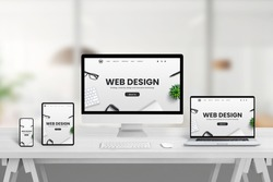Creative web design studio desk with different devices and responsive web page concept on device screens. Modern flat web site design concept