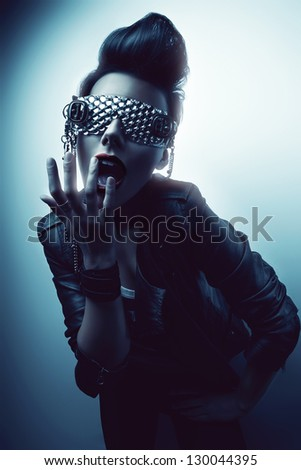 creative woman in glasses in light