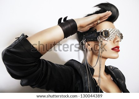 creative woman in glasses with chain