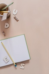 Creative workplace top view. Education, learning, study stationary on the table with copy space. Blank paper notepad for diary, plan flat lay. Minimalistic trendy back to school mockup