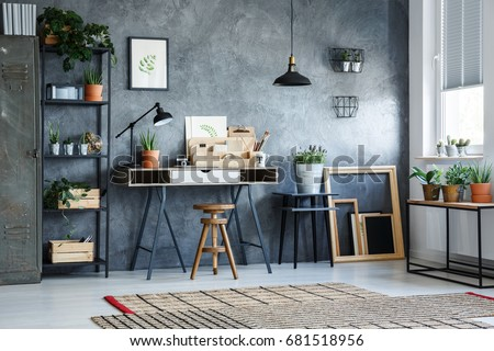 Creative workspace with desk in office room with gray wall