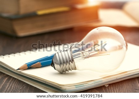 Creative Writing bulbs and pencils on a desk. #419391784