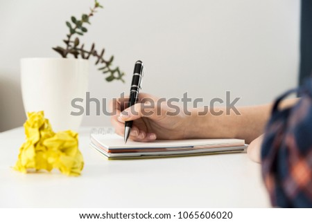 5fb5a7b8e613 Creative writing concept with notebook and crumpled paper balls. Editing  and copywriting workplace.