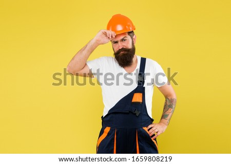 Creativity and practice. Major renovation places strong emphasis natural materials and sustainability. Improvement and renovation. Brutal man builder. Engineer builder uniform. Man builder hard hat.