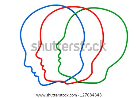 Creativity concept. Contours of three color head on a white background