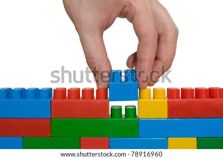 creativity concept. hand building up lego wall.