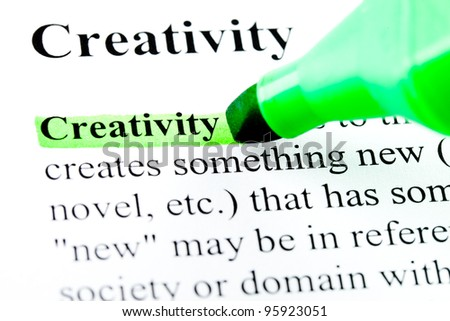 Creativity concept in dictionary highlighted by green marker