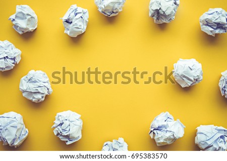 Creativity inspiration,ideas concepts with paper crumpled ball on pastel color background.Flat lay design.