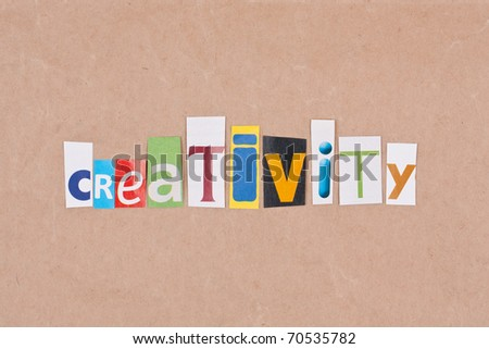 Creativity, letters sorted on paper background