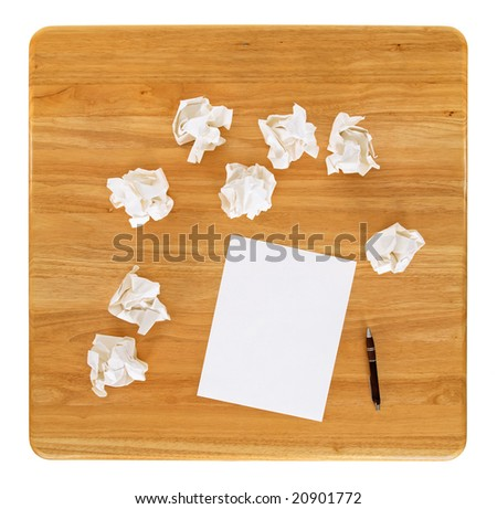 Creativity problems. Blank sheet of paper and crumpled paper wads.
