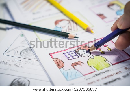 Creator drawing Story board movie video layout for pre-production, development cartoon illustration animation for process media films in form displayed script film production. Media product concept. #1237586899