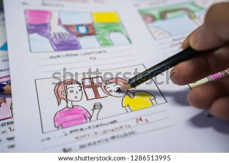 Creator drawing Story board movie video layout for pre-production, development cartoon illustration animation for process media films in form displayed script film production. Media product concept.