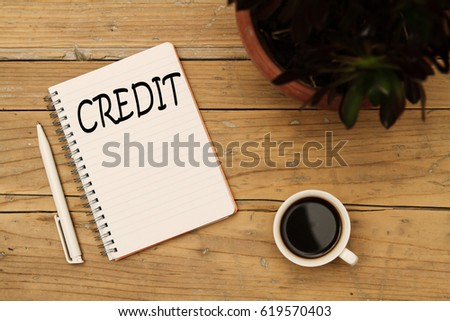 Credit analysis concept. Pen, notebook and coffee. Wooden table background. - Shutterstock ID 619570403