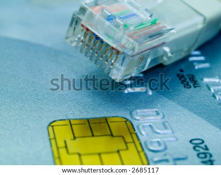 Credit card and a network cable representing online shopping. Shallow DOF.