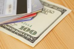 Credit card and 100 dollar close-up