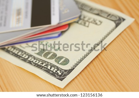 Credit card and 100 dollar close-up