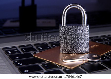 Credit card and lock on keyboard close up