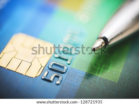 Credit card and pen close up