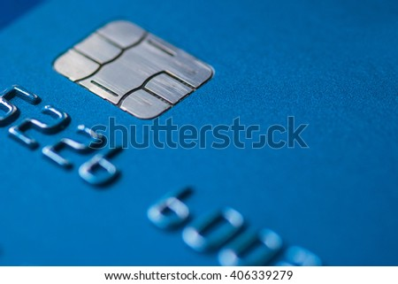 Credit Card blue with chip partial number selective focus close up macro empty space atm emv #406339279