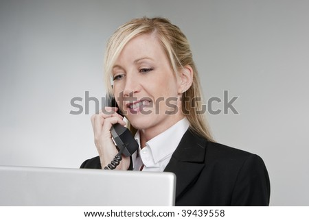Credit card customer service representative talking on the phone. - stock photo