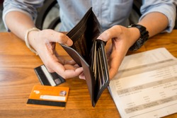 credit card debt - holding an empty wallet.