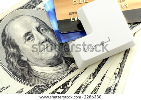 credit card, Dollars and a enter key, concept online shopping