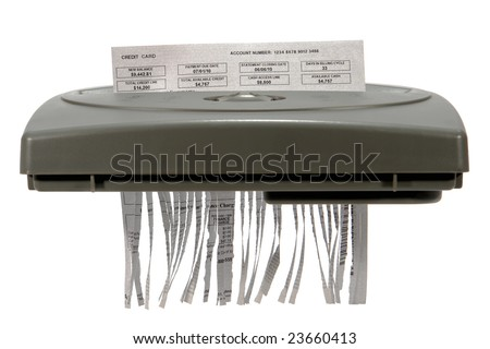 Credit card financial banking monthly statement shredded in cut strips in paper shredder for privacy protection and identity theft safety isolated on white (fictitious document with authentic content) - stock photo