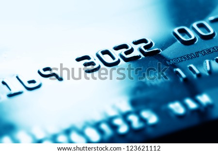 Credit card in blue tone. Selective focus.