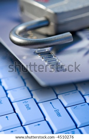 Credit card, lock, and a computer laptop keyboard for safety and security on the internet