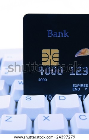 Credit card on a computer keyboard, on blue tone