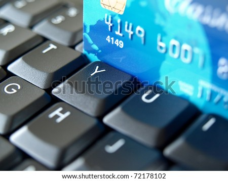 Credit card on computer keyboard.