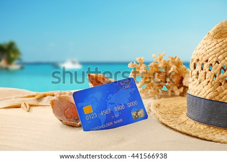 Credit card on holiday on blurred resort background #441566938