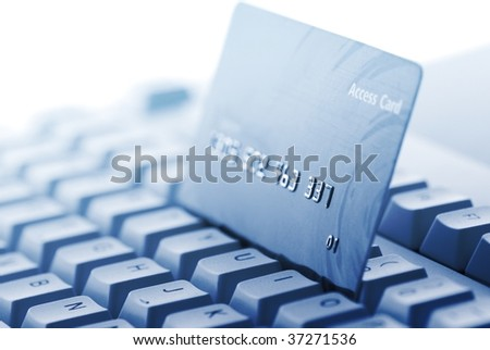 Credit card on keyboard,Closeup(toned blue).